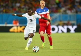 Ghana defensive midfielder Kwadwo Asamoah dribbling past U.S. attacking midfielder Michael Bradley.