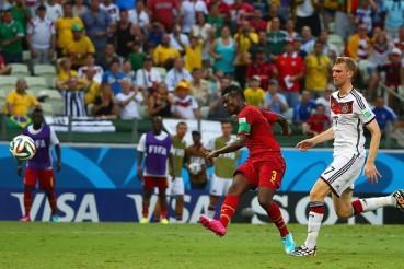 Ghana forward Asamoah Gyan scoring against Germany.