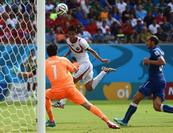 Costa Rica's Bryan Ruiz using his head to score the only goal in a win over Italy.