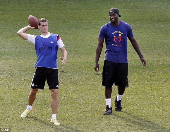 Real Madrid superstar Gareth Bale tossing the ole pigskin around before a match against Manchester United in Michigan's Big House.
