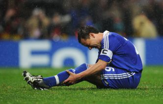 The Captain, John Terry, in agony after his big miss.