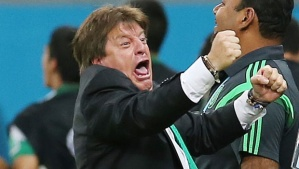 Mexico coach Miguel Herrera celebrating at the 2014 World Cup