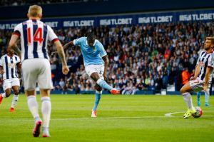 Yaya with his trademark right-footed curler
